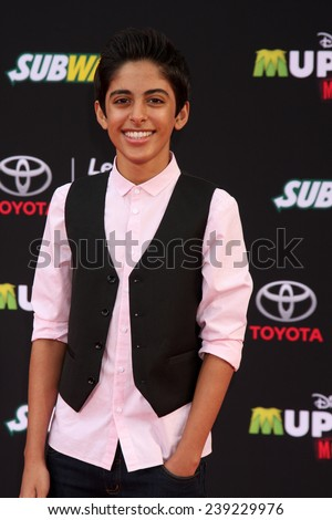 "LOS ANGELES - MAR 11:  Karan Brar at the ""Muppets Most Wanted"" - Los Angeles Premiere at the El Capitan Theater on March 11, 2014 in Los Angeles, CA"