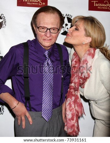 LOS ANGELES - MAR 25:  Larry King Wax figure (Purple shirt), Shawn Southwick King arriving at the Charlie Awards at Hollywood Roosevelt Hotel on March 25, 2011 in Los Angeles, CA - stock photo