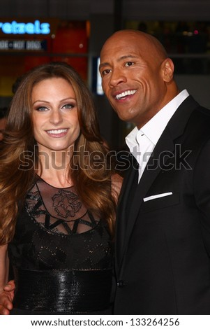 """LOS ANGELES - MAR 28:  Lauren Hashian, Dwayne Johnson arrives at the """"G.I. Joe: Retaliation""""  LA Premiere at the Chinese Theater on March 28, 2013 in Los Angeles, CA - stock photo"""