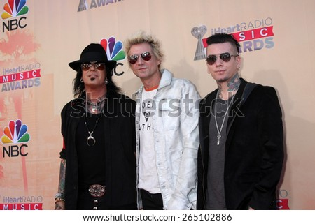 LOS ANGELES - MAR 29:  Nikki Sixx, James Michael, DJ Ashba at the 2015 iHeartRadio Music Awards at the Shrine Auditorium on March 29, 2015 in Los Angeles, CA - stock photo