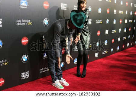 LOS ANGELES - MAR 20: Pharrell Williams, Helen Lasichanh at the 2nd Annual Rebels With A Cause Gala at Paramount Studios on  March 20, 2014 in Los Angeles, California - stock photo