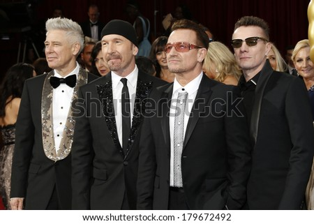 LOS ANGELES - MAR 2:  The Edge, Adam Clayton, Bono, Larry Mullen Jr. at the 86th Academy Awards at Dolby Theater, Hollywood & Highland on March 2, 2014 in Los Angeles, CA - stock photo