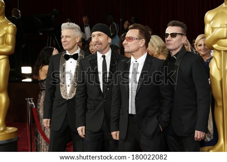LOS ANGELES - MAR 2:: The Edge, Adam Clayton, Bono, Larry Mullen Jr.  at the 86th Annual Academy Awards at Hollywood & Highland Center on March 2, 2014 in Los Angeles, California - stock photo