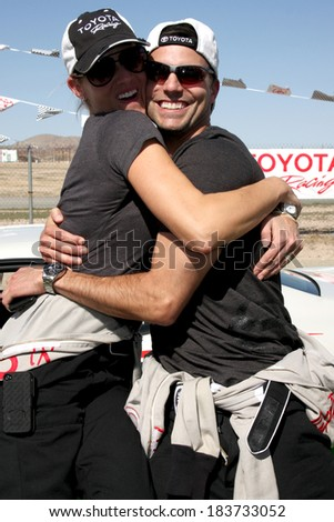 LOS ANGELES - MAR 15:  Tricia Helfer, Colin Egglesfield at the Toyota Grand Prix of Long Beach Pro-Celebrity Race Training at Willow Springs International Speedway on March 15, 2014 in Rosamond, CA - stock photo