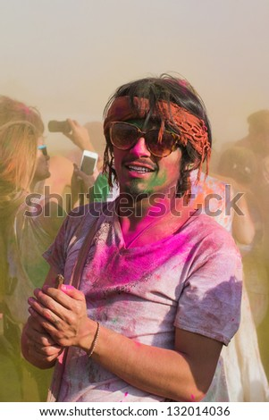 LOS ANGELES - MARCH 16 : Celebrant covered in color. Holi Festival of Colors on March 16, 2013 in Los Angeles, CA - stock photo