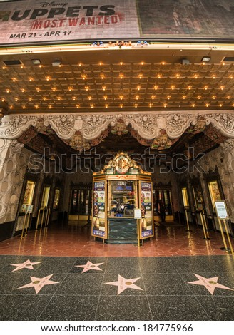 LOS ANGELES - MARCH 29: El Capitan Theater on March 29, 2014 in Hollywood. El Capitan Theatre is a fully restored movie palace at 6838 Hollywood Boulevard in Hollywood. - stock photo
