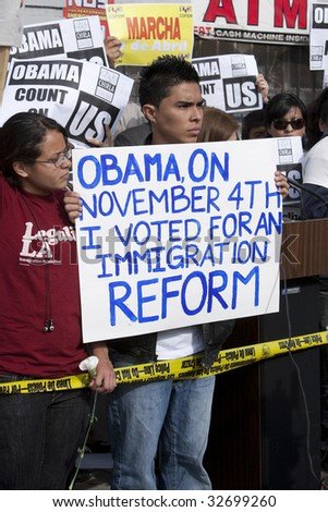 LOS ANGELES - MARCH 19: Immigration rights demonstrators from CHIRLA rally at President Barack Obama's town hall meeting in Los Angeles on March 19th, 2009. - stock photo