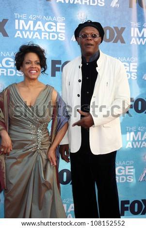 LOS ANGELES -  MARCH 4: Samuel L. Jackson, guest arriving at the 42nd NAACP Image Awards at Shrine Auditorium on March 4, 2011 in Los Angeles, CA - stock photo