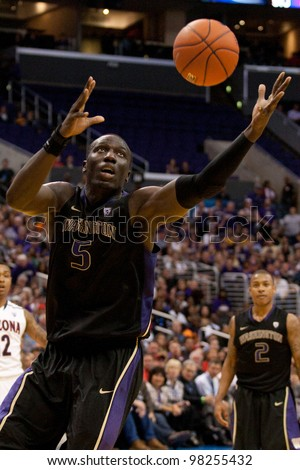LOS ANGELES - MARCH 12: Washington Huskies C Aziz N'Diaye in action during the NCAA Pac-10 Tournament basketball championship game  on March 12 2011 at Staples Center in Los Angeles, CA. - stock photo