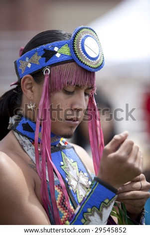 LOS ANGELES - MAY 2: American Indian of the Navajo Nation prepares to dance in the Grand Entry at the 24th Annual UCLA Pow Wow on May 2, 2009 in Los Angeles. - stock photo
