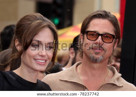 "LOS ANGELES - MAY 22:  Angelina Jolie, Brad Pitt arriving at the ""Kung Fu Panda 2"" Los Angeles Premiere at Grauman's Chinese Theatre on May 22, 2011 in Los Angeles, CA - stock photo"