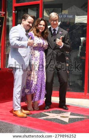 LOS ANGELES - MAY 19:  Ben Falcone, Melissa McCarthy, Paul Feig at the Melissa McCarthy Hollywood Walk of Fame Ceremony at the TCL Chinese Theater on May 19, 2015 in Los Angeles, CA - stock photo
