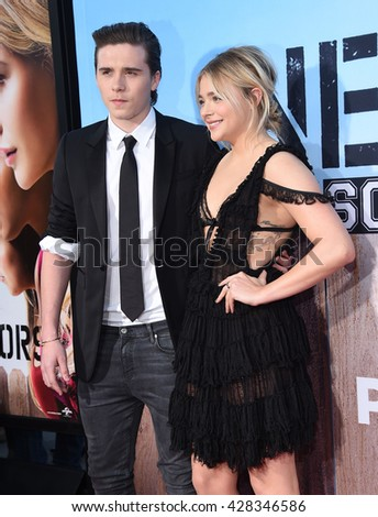 """LOS ANGELES - MAY 16:  Brooklyn Beckham & Chloe Grace Moretz arrives to the """"Neighbors 2: Sorority Rising"""" Los Angeles Premiere  on May 16, 2016 in Hollywood, CA.                 - stock photo"""