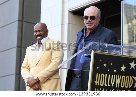 LOS ANGELES - MAY 13: Dr Phil McGraw, Steve Harvey at a ceremony where Steve Harvey is honored with a star on the Hollywood Walk Of Fame on May 13, 2013 in Los Angeles, California - stock photo