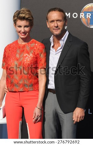"""LOS ANGELES - MAY 9:  Faith Hill, Tim McGraw at the """"Tomorrowland"""" Premiere at the AMC Downtown Disney on May 9, 2015 in Lake Buena Vista, CA - stock photo"""