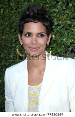 LOS ANGELES - MAY 19:  Halle Berry arriving at the Opening Night of the Beauty Culture Exhibit at The Annenberg Space For Photography on May 19, 2011 in Century City, CA - stock photo