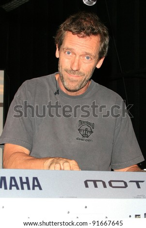 LOS ANGELES - MAY 25: Hugh Laurie practices with the Band From TV at a studio in Los Angeles, California on May 25, 2008 - stock photo