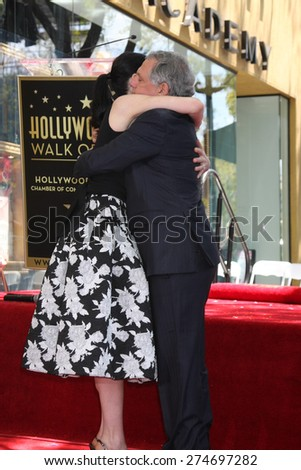 LOS ANGELES - MAY 1:  Julianna Margulies, Les Moonves at the Julianna Margulies Hollywood Walk of Fame Star Ceremony at the Hollywood Boulevard on May 1, 2015 in Los Angeles, CA - stock photo