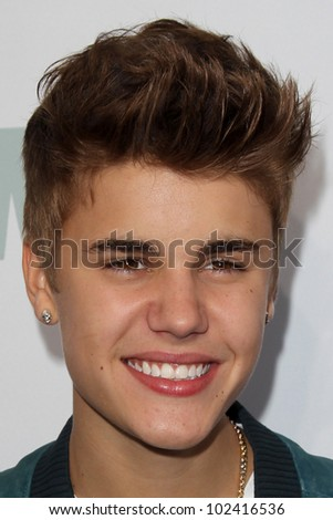 "LOS ANGELES - MAY 12:  Justin Bieber arrives at the ""Wango Tango"" Concert at The Home Depot Center on May 12, 2012 in Carson, CA - stock photo"