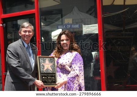 LOS ANGELES - MAY 19:  Leron Gubler, Melissa McCarthy at the Melissa McCarthy Hollywood Walk of Fame Ceremony at the TCL Chinese Theater on May 19, 2015 in Los Angeles, CA - stock photo