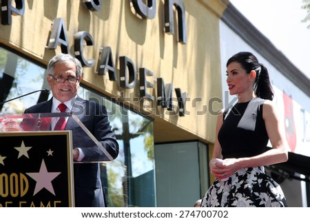 LOS ANGELES - MAY 1:  Les Moonves, Julianna Margulies at the Julianna Margulies Hollywood Walk of Fame Star Ceremony at the Hollywood Boulevard on May 1, 2015 in Los Angeles, CA - stock photo
