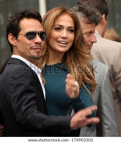 LOS ANGELES - MAY 23:  Marc Anthony & Jennifer Lopez arrives to the Walk of Fame Ceremony for Simon Fuller  on May 23, 2011 in Hollywood, CA                 - stock photo