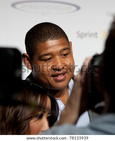 LOS ANGELES - MAY 22:Omar Benson Miller arrives at 2011 Cedars Sinai Sports Spectacular Los Angeles, CA on May 12, 2011. - stock photo