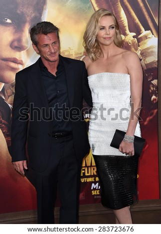 """LOS ANGELES - MAY 07:  Sean Penn & Charlize Theron arrives to the """"Mad Max: Fury Road"""" Los Angeles Premiere  on May 7, 2015 in Hollywood, CA                 - stock photo"""