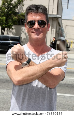 "LOS ANGELES - MAY 8:  Simon Cowell, one of the talent judges,  arriving at the ""X-Factor Auditions"" at Galen Center on May 8, 2011 in Los Angeles, CA - stock photo"
