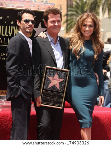 LOS ANGELES - MAY 23:  Simon Fuller, Marc Anthony & Jennifer Lopez arrives to the Walk of Fame Ceremony for Simon Fuller  on May 23, 2011 in Hollywood, CA                 - stock photo