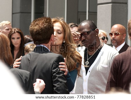 LOS ANGELES - MAY 23:  Simon Fuller receiving congratulations from Jennifer Lopez at his Hollywood Walk of Fame Star Ceremony at Hollywood Blvd on May 23, 2011 in Los Angeles, CA. - stock photo