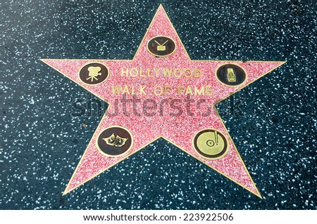 LOS ANGELES - MAY 11, 2012: Star of Hollywood Walk of Fame on May 11, 2012 in Los Angeles. There are more than 2,400 five-pointed stars which attract about 10 million visitors annually. - stock photo