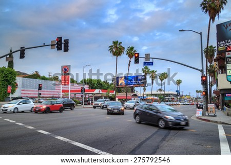 LOS ANGELES - May 06, 2015: Traffic at the intersection of Sunset Boulevard and Laurel Avenue at twilight. - stock photo
