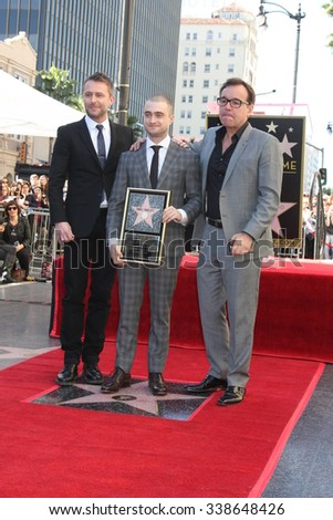 LOS ANGELES - NOV 12:  Chris Hardwick, Daniel Radcliffe, Chris Columbus at the Daniel Radcliffe Hollywood Walk of Fame Ceremony at the Hollywood Walk of Fame on November 12, 2015 in Los Angeles, CA - stock photo