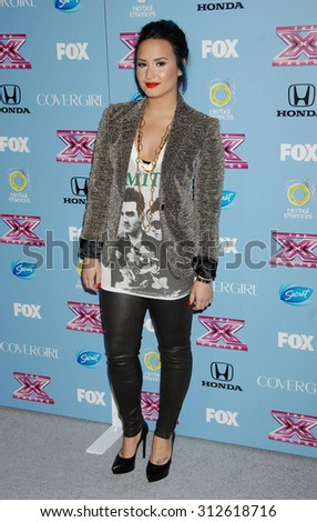 LOS ANGELES - NOV 4:  Demi Lovato arrives at 2013 The X Factor Top 12 Finalists  Premiere  on November 4, 2013 in Beverly Hills, CA                 - stock photo