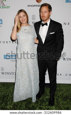 LOS ANGELES - NOV 9:  Drew Barrymore and husband Will Kopelman arrives at the 2nd Annual Baby2Baby Gala  on November 9, 2013 in Culver City, CA                 - stock photo