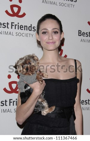 LOS ANGELES - NOV 13: Emmy Rossum and her dog Cinnamon at the 15th annual Lint Roller Party at the Palladium in Hollywood on 13 November 2008 in Los Angeles, California - stock photo