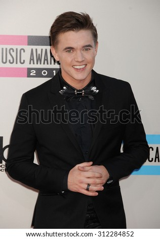 LOS ANGELES - NOV 24:  Jesse McCartney arrives at the 2013 American Music Awards Arrivals  on November 24, 2013 in Los Angeles, CA                 - stock photo