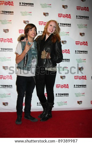 LOS ANGELES - NOV 22:  Jimmy Bennett, Elizabeth Stanton at the 2011 Hollywood Christmas Parade Concert at Universal Citywalk on November 22, 2011 in Los Angeles, CA