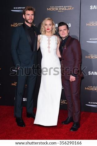 "LOS ANGELES - NOV 16:  Liam Hemsworth, Jennifer Lawrence & Josh Hutcherson arrives ""The Hunger Games: Mocking Jay - Part 2"" Los Angeles Premiere  November 16, 2015 in Los Angeles, CA.                 - stock photo"