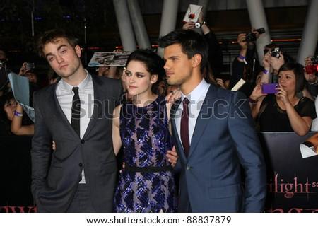 "LOS ANGELES - NOV 14:Robert Pattinson, Kristen Stewart, Taylor Lautner arrive at the ""Twilight: Breaking Dawn Part 1"" World Premiere at Nokia Theater at LA LIve on November 14, 2011 in Los Angeles, CA - stock photo"