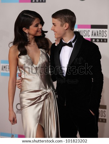 LOS ANGELES - NOV 20:  Selena Gomez & Justin Bieber arrives to the American Music Awards 2011  on November 20, 2011 in Los Angeles, CA - stock photo