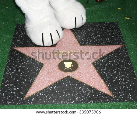 LOS ANGELES - NOV 2:  Snoopy's paws with Star at the Snoopy Hollywood Walk of Fame Ceremony at the Hollywood Walk of Fame on November 2, 2015 in Los Angeles, CA - stock photo