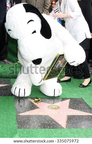 LOS ANGELES - NOV 2:  Snoopy with the WOF star for Charles Schultz at the Snoopy Hollywood Walk of Fame Ceremony at the Hollywood Walk of Fame on November 2, 2015 in Los Angeles, CA - stock photo