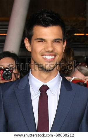 "LOS ANGELES - NOV 14:  Taylor Lautner arrives at the ""Twilight: Breaking Dawn Part 1"" World Premiere at Nokia Theater at LA LIve on November 14, 2011 in Los Angeles, CA - stock photo"