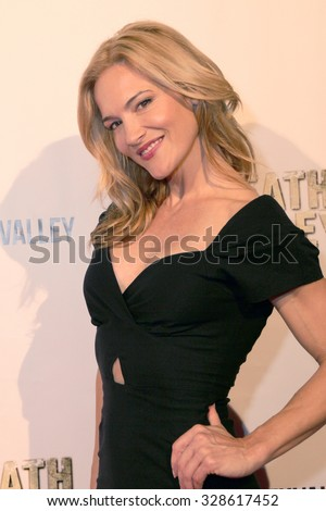 "LOS ANGELES- OCT 17: Actress Victoria Pratt arrives at the ""Death Valley"" film premiere Oct. 17, 2015 at Raleigh Studios in Los Angeles, CA. - stock photo"