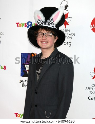 LOS ANGELES - OCT 30:  Angus T. Jones arrives at the 17th Annual Dream Halloween benefiting CAAF at Barker Hanger on October 30, 2010 in Santa Monica, CA