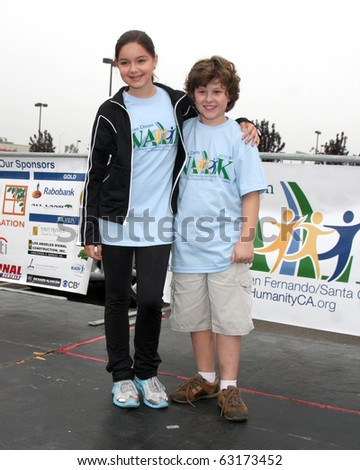 "LOS ANGELES - OCT 16:  Ariel Winter, Nolan Gould at the Habitat for Humanity San Fernando/Santa Clarita Valley's ""American Dream Walk""  at Pacoima Plaza on October 16, 2010 in Pacoima, CA - stock photo"