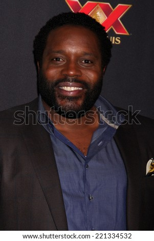 "LOS ANGELES - OCT 2:  Chad L. Coleman at the ""The Walking Dead"" Season 5 Premiere at Universal City Walk on October 2, 2014 in Los Angeles, CA - stock photo"