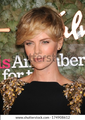 LOS ANGELES - OCT 17:  Charlize Theron arrives to the Wallis Annenberg Center for the Performing Arts Gala  on October 17, 2013 in Beverly Hills, CA                 - stock photo